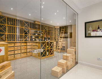 Large private wine cellar in Wimbledon, London using solid Oak racking