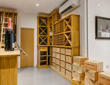 Large private wine room in Wimbledon, London using solid Oak racking