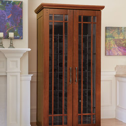 Le Cache Mission 2400 Wine Cabinet Classic Cherry - Designed by Berkeley Mills, an acclaimed Bay-area designer of high-quality artisan furniture, our Mission Series wine cabinets combine straight lines and beautiful wood grains to achieve the timeless beauty of fine arts & crafts furniture. The Mission 1400 is perfectly sized for beginning wine collectors, and features a window with engineered wood mullions, crown molding and hand-carved detailing. Engineered to create optimal storage conditions for protecting and preserving fine wine collections, the Mission 1400 provides digital temperature and adjustable humidity control while offering advanced protection from harmful UV rays and vibration inside the wine cabinet. Every wine cabinet from Le Cache features all-wood Interlock racking that will accommodate large-format bottles, such as Burgundy, Pinot Noir and many Champagne bottles. Premium wood veneer and choice of hand-stained finishes is included.