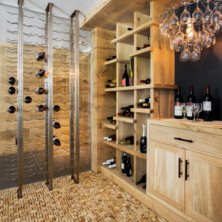 Photo of a contemporary wine cellar in Boston with storage racks, cork flooring and yellow floors.