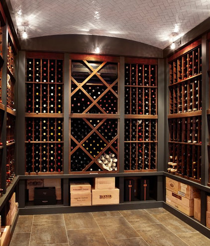 Traditional Wine Cellar by LG Construction + Development