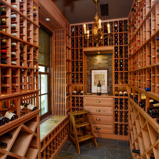 Example of a coastal gray floor wine cellar design in Other with storage racks