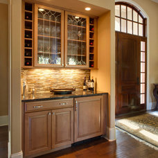 Traditional Wine Cellar by Winslow Kitchen Studio