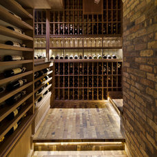 Rustic Wine Cellar by Allwood Construction Inc