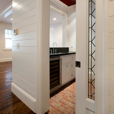 Traditional Wine Cellar by Chelsea Court Designs