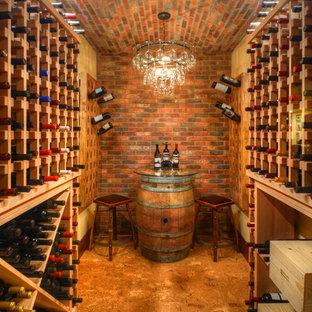 Idée de décoration pour une cave à vin chalet avec un sol en linoléum et des casiers.