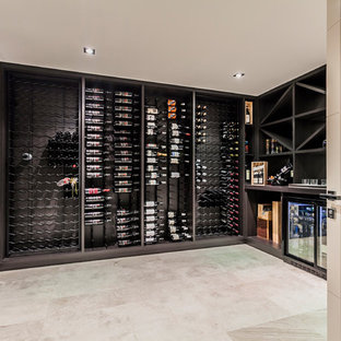 Inspiration for a contemporary wine cellar in Perth with storage racks and beige floor.