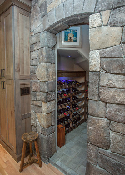 Rustic Wine Cellar by Maughan Design & Remodel