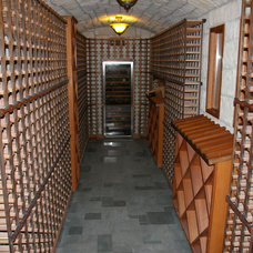 Traditional Wine Cellar by The Cabinet Shop