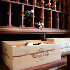 Traditional Wine Cellar by The Furniture Guild