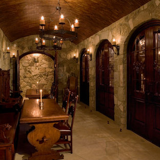 Example of a classic wine cellar design in Austin with storage racks