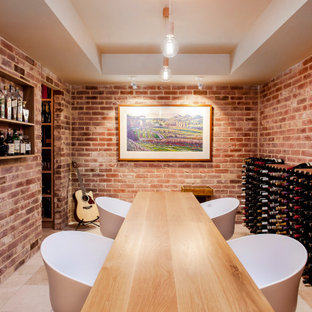 Design ideas for a large transitional wine cellar in Adelaide with storage racks and beige floor.