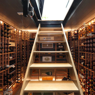 Example of a small trendy wine cellar design in Auckland with storage racks