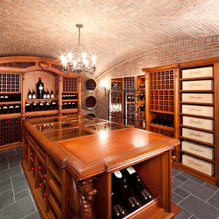 This is an example of an expansive classic wine cellar in New York with display racks and grey floors.
