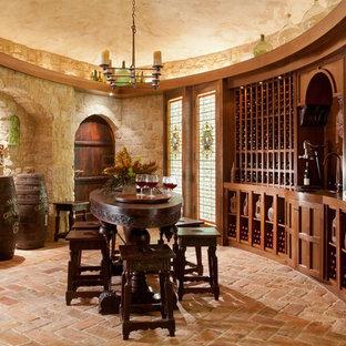 Inspiration för en medelhavsstil vinkällare, med tegelgolv och rosa golv