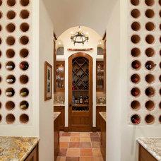 Mediterranean Wine Cellar by Phillip Jennings Custom Homes