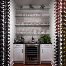 Mediterranean Wine Cellar by Romanza Interior Design