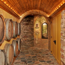 Mediterranean Wine Cellar by Teakwood Builders, Inc.