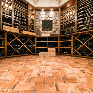 Design ideas for a large classic wine cellar in New York with brick flooring, storage racks and orange floors.