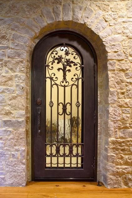 Mediterranean Wine Cellar by Allwood Construction Inc
