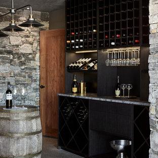 Modern wine cellar in Sunshine Coast with concrete floors, diamond bins and grey floor.