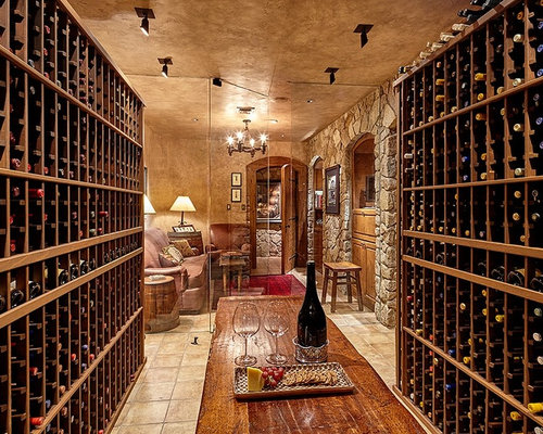 example of a classic wine cellar design in seattle with travertine floors storage racks and