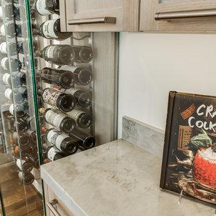 Mid-sized midcentury wine cellar in Dallas with medium hardwood floors and display racks.