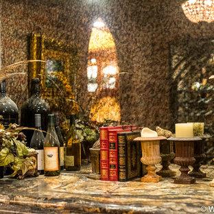 Ejemplo de bodega rústica, de tamaño medio, con suelo de mármol, botelleros y suelo amarillo