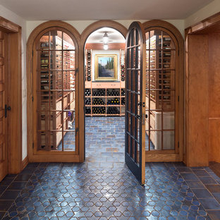 Inspiration for a timeless blue floor wine cellar remodel in Minneapolis with storage racks