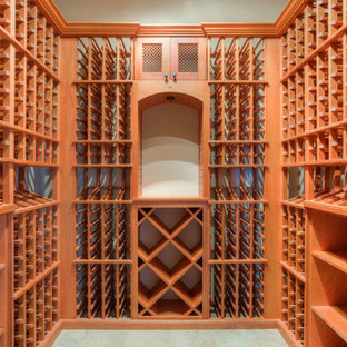 Small classic wine cellar in Austin with porcelain flooring and storage racks.