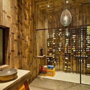 Mid-sized urban wine cellar photo in Orange County with storage racks
