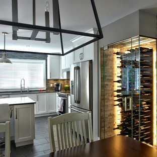 Inspiration For A Small Modern Ceramic Floor Wine Cellar Remodel In  Montreal With Display Racks