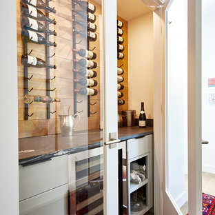Small transitional medium tone wood floor and brown floor wine cellar photo in Richmond with display racks