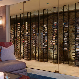 Inspiration for a large modern porcelain floor and beige floor wine cellar remodel in Vancouver with storage racks