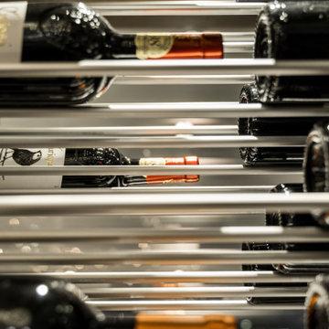 Modern Wine Cellar With Sleek Racking, Enclosed In Glass