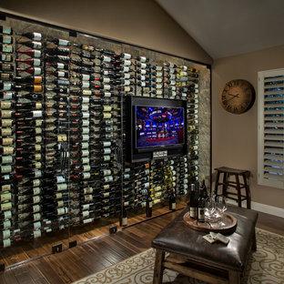 Inspiration för en mellanstor funkis vinkällare, med målat trägolv, vinhyllor och brunt golv