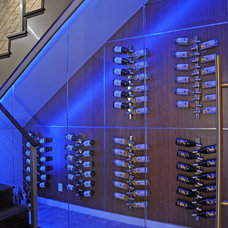 Modern Wine Cellar by DTM INTERIORS