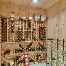 Contemporary Wine Cellar by CONSTRUCTEUR GENERAL LC INC