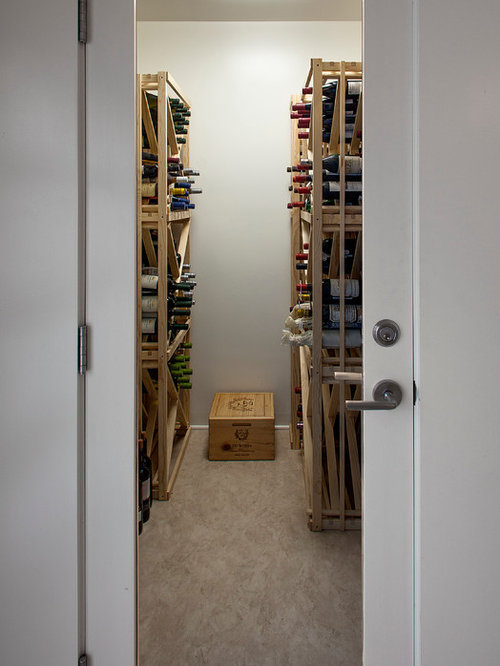 Small wine cellar design ideas renovations photos with for Wine cellar flooring options