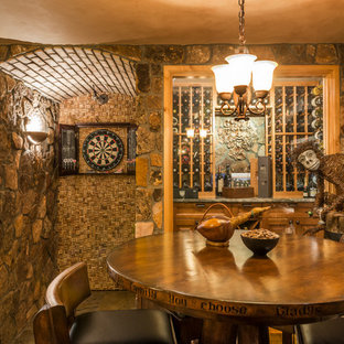 Inspiration for a rustic wine cellar remodel in Denver with storage racks