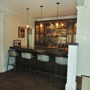 This is an example of a medium sized vintage wine cellar in New York with medium hardwood flooring and display racks.
