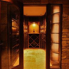 Traditional Wine Cellar by Inviniti Cellar Design