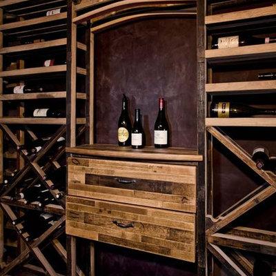 Wine cellar - mid-sized craftsman ceramic tile wine cellar idea in Los Angeles with display racks