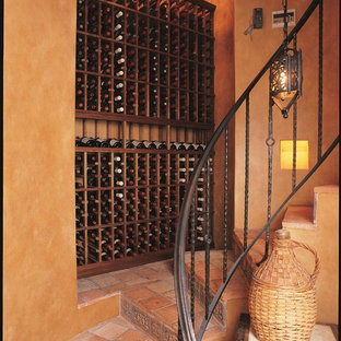 Inspiration for a large traditional wine cellar in Orange County with terracotta flooring and display racks.