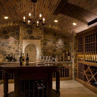 Wine cellar - mid-sized traditional wine cellar idea in Providence with storage racks