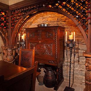 ミネアポリスの小さいエクレクティックスタイルのおしゃれなワインセラー (ライムストーンの床、ワインラック) の写真