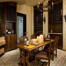 Traditional Wine Cellar by TATUM BROWN CUSTOM HOMES