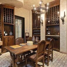 Traditional Wine Cellar by Symmetry Architects
