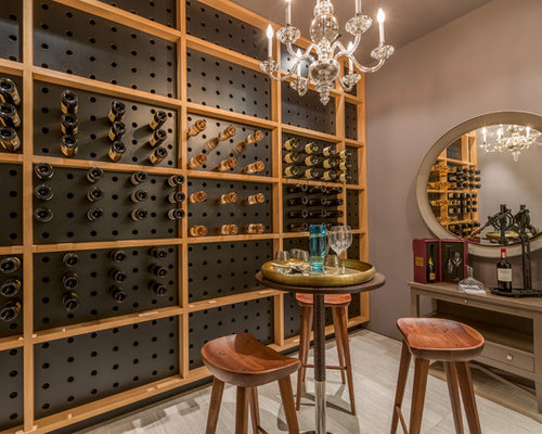 trendy wine cellar photo in miami with storage racks and gray floors