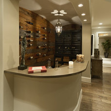 Traditional Wine Cellar by Frankel Building Group